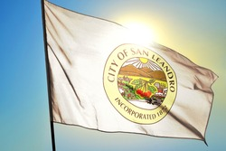 San Leonardo of California of United States flag waving on the wind in front of sun