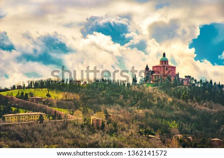 San Luca basilica in Bologna  hills with the long porch archway - Italy .