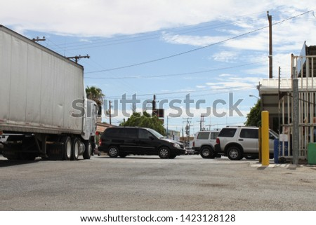 San Luis, Ariz. / US - September 29, 2010: Semi trucks with economic freight, going both north and south, are a major part of traffic at the Port of Entry. #1423128128