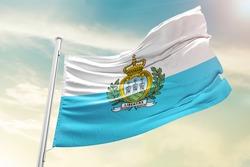 San Marino national flag cloth fabric waving on the sky  - Image