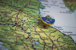 San Marino pinned on a map with flag of San Marino