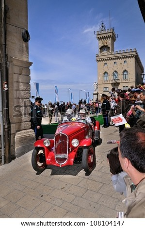 SAN MARINO RSM - MAY 18: Red 1934 Fiat 508 Balilla driven by M. Bettinsoli takes part to the 1000 Miglia 2012, on May 18, 2012 in San Marino