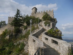 San Marino, the Witches Pass. Panorama of the path with the stairway carved into the rock towards the First Tower perched on a rock overlooking the surrounding area and the sea