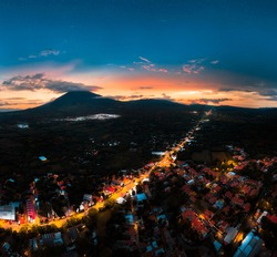 San Miguel city - El Salvador   at night with a sunset in the background next to the chaparrastique volcano