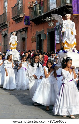 SAN MIGUEL DE ALLENDE, MEXICO - APRIL 6: Unidentified local children in a Good Friday procession on April 6, 2007 in San Miguel de Allende, Mexico. The 4 mile parade attracts thousands of visitors. - stock photo
