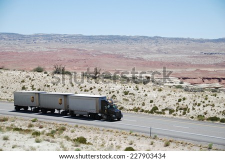 SAN RAFAEL VALLEY, UT, USA - JUNE 6, 2008: a truck drives through San Rafael desert on Route 70. Trucks carry nearly 70 percent of all freight transported annually in the U.S.