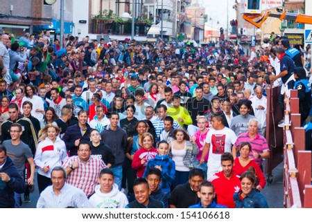 SAN SEBASTIAN DE LOS REYES, SPAIN - AUGUST 29:   Running of the Bulls in August 29, 2013 in San Sebastian de los Reyes, Spain. Running crowd of people