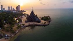 Sanctuary of Truth temple construction on sunset in Pattaya, Thailand , teak essence of temple of Pattaya Thailand