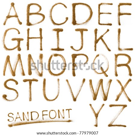 Sand ABC containing letters,isolated on white background