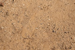Sand and glass background. Texture ground, dirt, glass background.