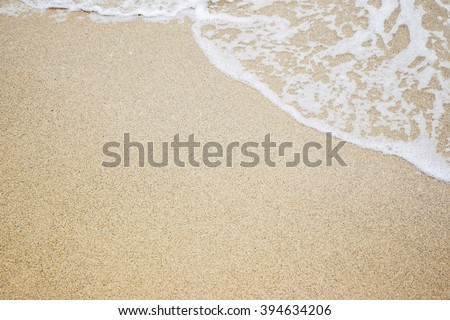 Sand and wave at the beach background. Drop space on bottom right for text and other. #394634206