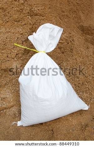 Sand bags help keep flood waters out of a town Process Flood protection