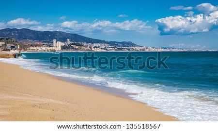 Sand beach and mediterranean sea at Badalona. Catalonia, Spain