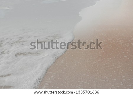Sand beach and wave bubbles. The picture of the beautiful of wave and sand on the beach was adjust to be abstract picture make relax feeling.