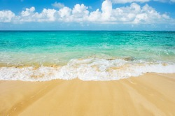 Sand beach, blue sea and cloudy sky. Summer travel background