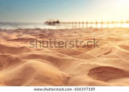 Sand beach tropical with blurred sea sky and sunny background, summer day, copy space or for product. #606197189