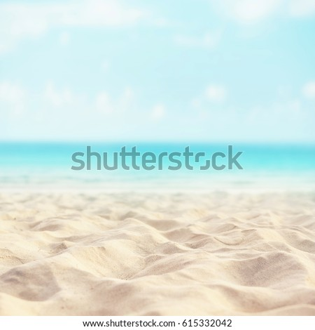 Sand beach tropical with blurred sea sky and sunny background, summer day, copy space or for product. #615332042