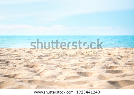 Sand beach with blue sea and blue sky and white cloud blured at coast. beautiful blue ocean shore outdoor nature landscape  background. tourist summer travel holidays tropical season concept.
