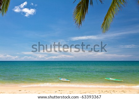 Sand beach with canoes in Phu Quoc, Vietnam