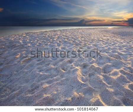 sand beach with rim light and dramatic sky