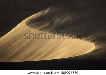Sand Blows from a sand dune in Sossusvlei. #569091580