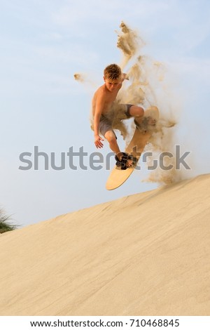 Sand boarding at Oregon Dunes National Recreation Area near Florence, Oregon