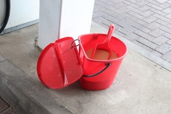 Sand bucket placed at Petrol station for spillage of fuel