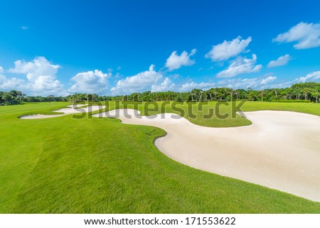 Sand bunkers on the beautiful golf course of the luxury Mexican resort Bahia Principe Riviera Maya