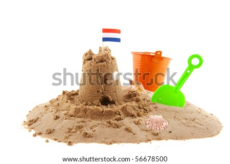 sand castle at the beach isolated white background