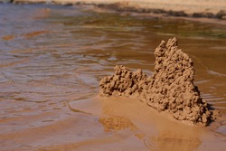 sand castle on the beach near the water. High quality photo