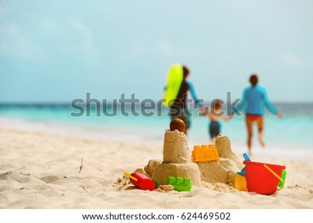 sand castle on tropical beach, family vacation #624469502