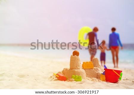 sand castle on tropical beach, family vacation concept
