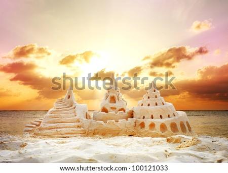 Sand Castle over Sunset on the Beach #100121033