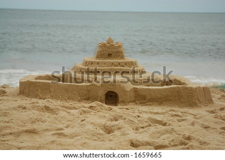 Sand castle  the beach with the ocean in the background