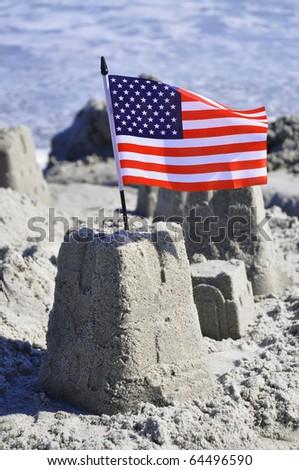 Sand Castle with American Flag on the beach