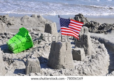 Sand Castle with American Flag on the beach