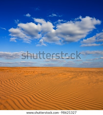sand desert and a blue cloudy sky
