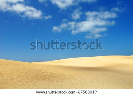 sand desert and blue sky with clouds