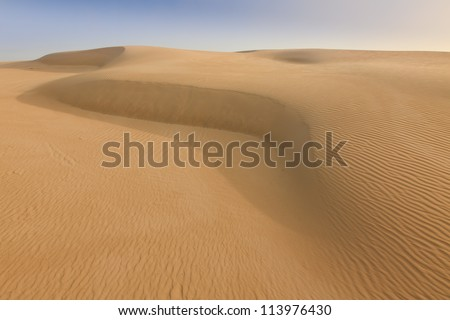 Sand dune desert day time dry wave of wild unexplored terrain hot and extreme place