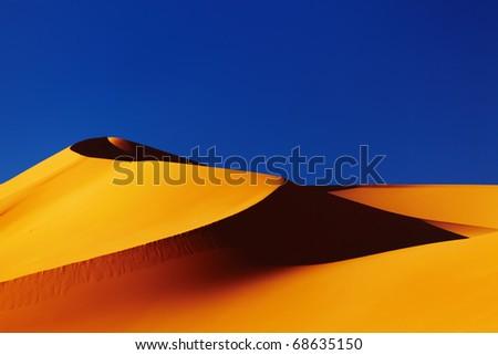 Sand dune in Sahara Desert at sunset, Algeria - stock photo