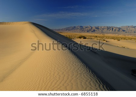 Sand dune near Stovepipe Wells in Death Valley at sunset