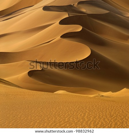 Sand dunes at sunset in the Sahara Desert, Libya. #98832962