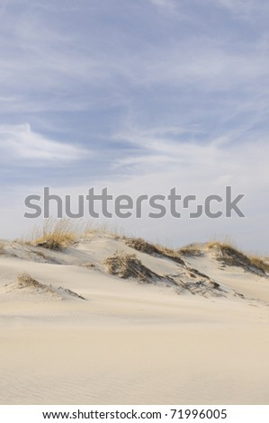 Sand dunes on windy day