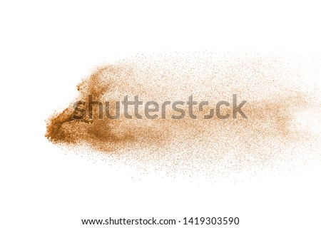 Sand explosion isolated on white background. Abstract sand cloud. Gold sand splash against on clear background.