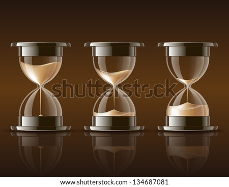 Sand falling in the hourglass in three different states on dark background.