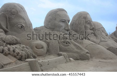 Sand figure on a  Spain beach. Spain. Costa Dorado.