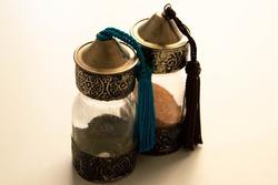 Sand glass bottle, morocco souvenir, glass jar with desert sand.