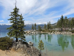 Sand Harbor offers hiking trails and scenic overlooks where photographers and hikers can enjoy the boulder studded turquoise water and tall pine trees against a backdrop of the regal Sierras.