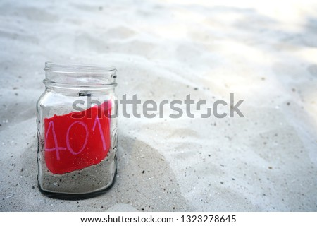 Sand jar on the beach  for savings and investment IRA 401k retirement. retirement concept
