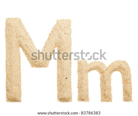 Sand letter isolated on white. One letter of Sand alphabet. Letter M